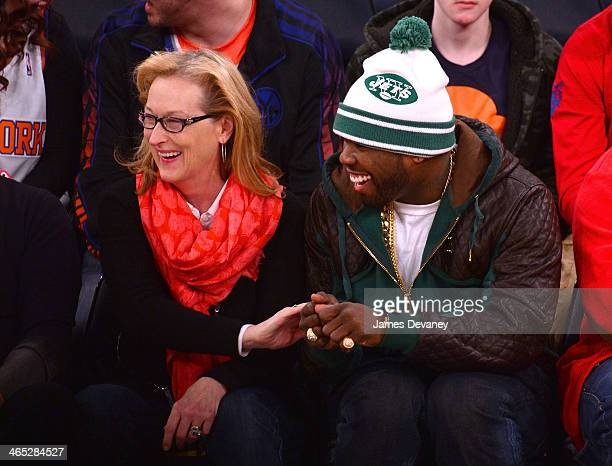 Meryl Streep and 50 Cent attend the Los Angeles Lakers vs New York Knicks game at Madison Square Garden on January 26 2014 in New York City