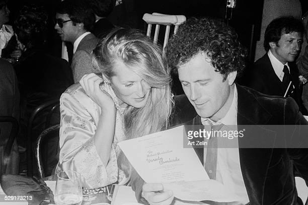 Meryl Streep and her husband looking at menu at restaurant circa 1970 New York