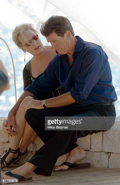 Meryl Streep and Pierce Brosnan talk during a photocall for the movie 'Mamma Mia' at the Lagonissi Grand Resort on June 28 2008 in AthensGreece