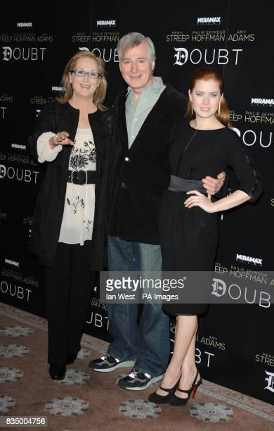 Meryl Streep director John Patrick Shanley and Amy Adams pose for pictures to promote latest film Doubt at Claridges Hotel in London