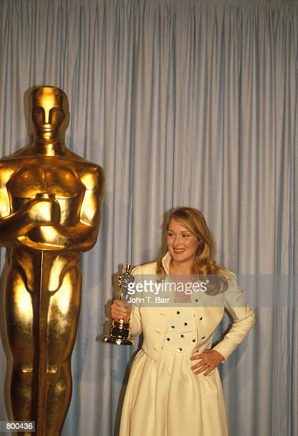 Meryl Streep holds her Oscar at the Academy Awards on April 1 1980 in Los Angeles CA Streep won the 1980 Best Supporting Actress Oscar for her role...