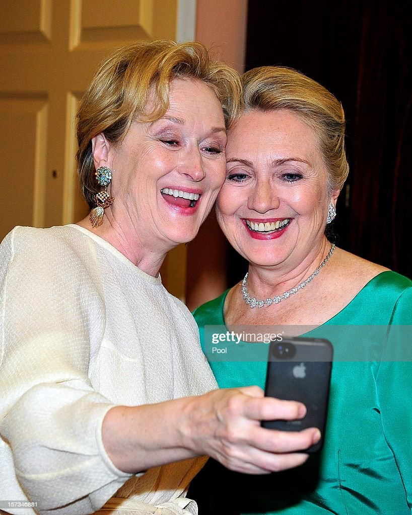 <a gi-track='captionPersonalityLinkClicked' href=/galleries/search?phrase=Meryl+Streep&family=editorial&specificpeople=171097 ng-click='$event.stopPropagation()'>Meryl Streep</a> takes a photo of herself with U.S. Secretary of State <a gi-track='captionPersonalityLinkClicked' href=/galleries/search?phrase=Hillary+Clinton&family=editorial&specificpeople=76480 ng-click='$event.stopPropagation()'>Hillary Clinton</a> following a dinner for Kennedy honorees hosted by U.S. Secretary of State Hillary Rodham Clinton at the U.S. Department of State on December 1, 2012 in Washington, DC. The 2012 honorees are Buddy Guy, actor Dustin Hoffman, late-night host David Letterman, dancer Natalia Makarova, and members of the British rock band Led Zeppelin Robert Plant, Jimmy Page, and John Paul Jones.