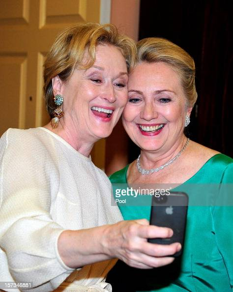 Meryl Streep takes a photo of herself with US Secretary of State Hillary Clinton following a dinner for Kennedy honorees hosted by US Secretary of...