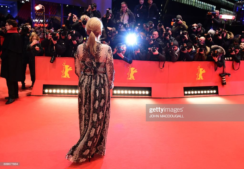 Meryl Streep US actress and jury president poses for photographers on the red carpet for the film 'Hail, Caesar!' screening as opening film of the 66th Berlinale Film Festival in Berlin on February 11, 2016. Eighteen pictures will vie for the Golden Bear top prize at the event which runs from February 11 to 21, 2016. / AFP / John MACDOUGALL