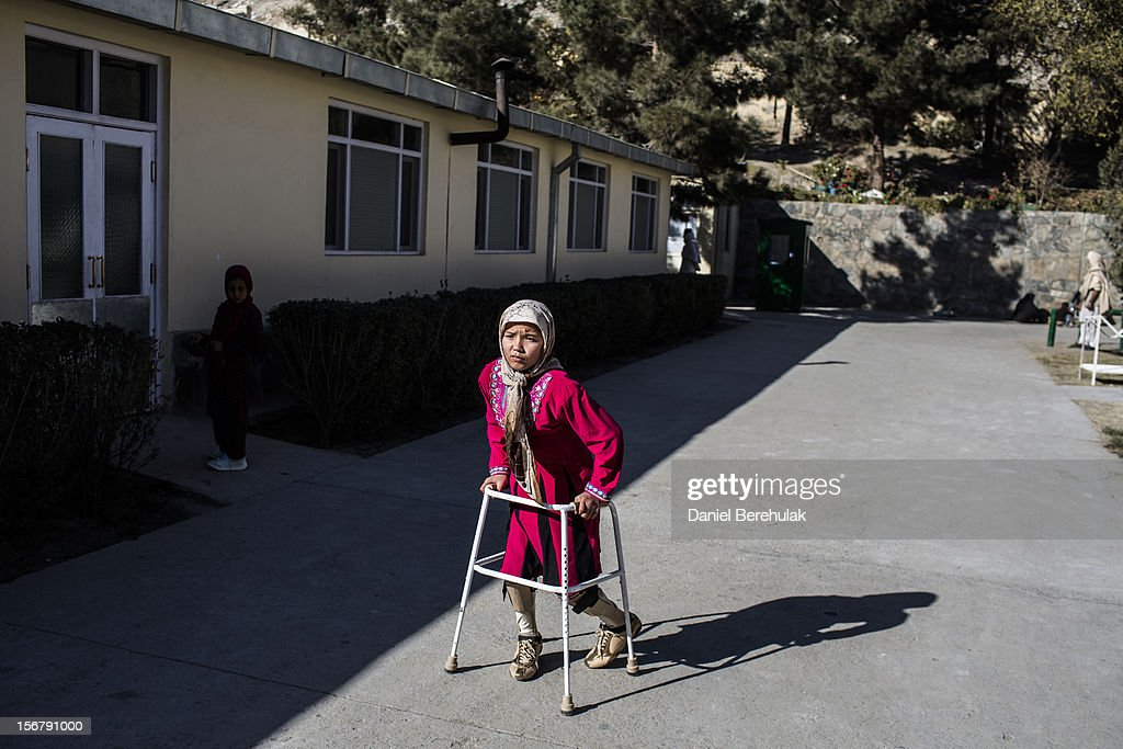 Merzia, 12, from Wardak province, suffering from congenital birth defects exercises with the aid of a walker at the International Committee of the Red Cross (ICRC), orthopedic centre on November 19, 2012 in Kabul, Afghanistan. The ICRC rehabilitation centre works to educate and rehabilitate land-mine victims, and those with limb related deformities, back into society and employment offering micro-credit financing, home schooling and vocational training to patients. The clinic itself is unique in that all of the workers are handicapped. The ICRC centre in Kabul has registered over 57,000 patients and 114,000 countrywide in all of their centres since its inception 25 years ago.