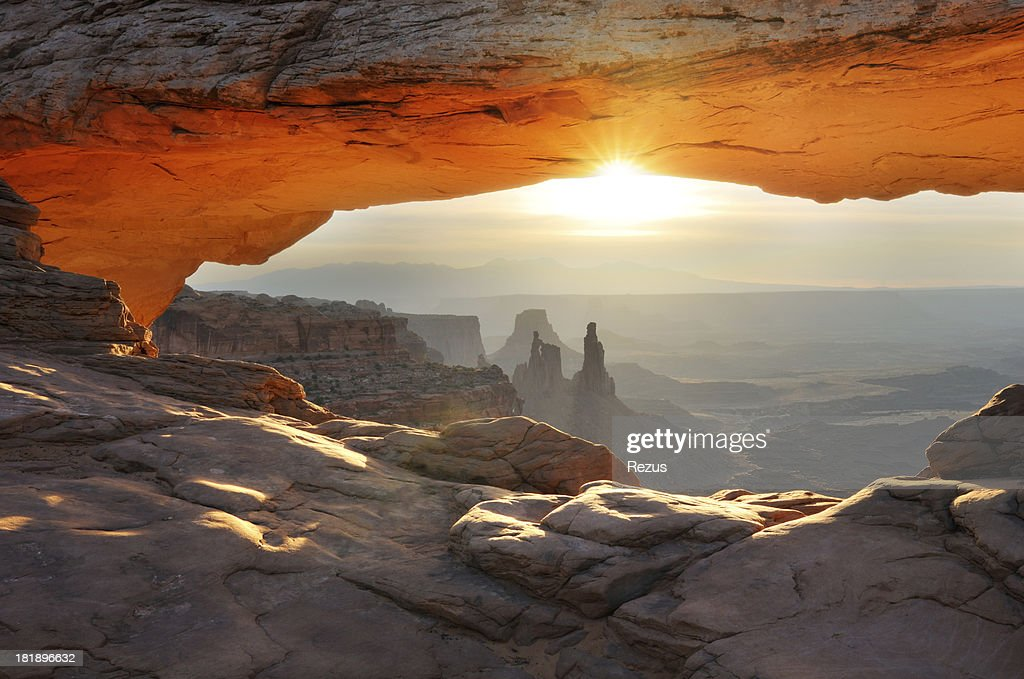 Mesa Arch sunrise landscape in Canyonlands National Park : Stock Photo
