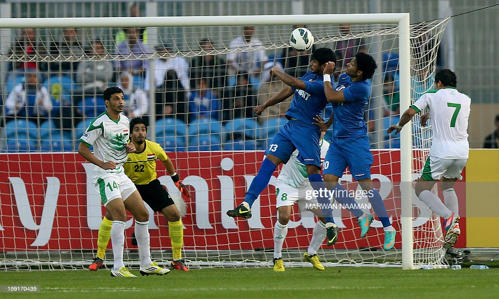 Mesaed al-Enezi (C) and Yousef al-Sulaiman (C-R) jump to send a header to the Iraqi goal during their 21st Gulf Cup football match in Manama on January 9, 2013.