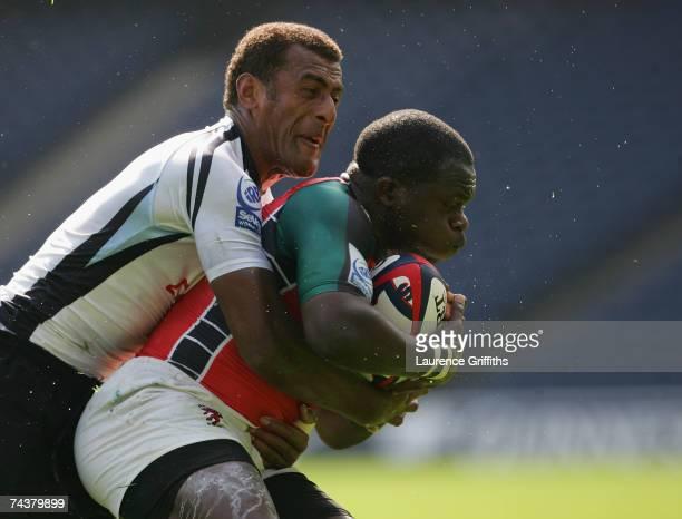 Mesake Davu Narogo of Fiji battles with Victor Sudi Simiyu of Kenya during the IRB Edinburgh Sevens match between Fiji and Kenya at Murrayfiled on...