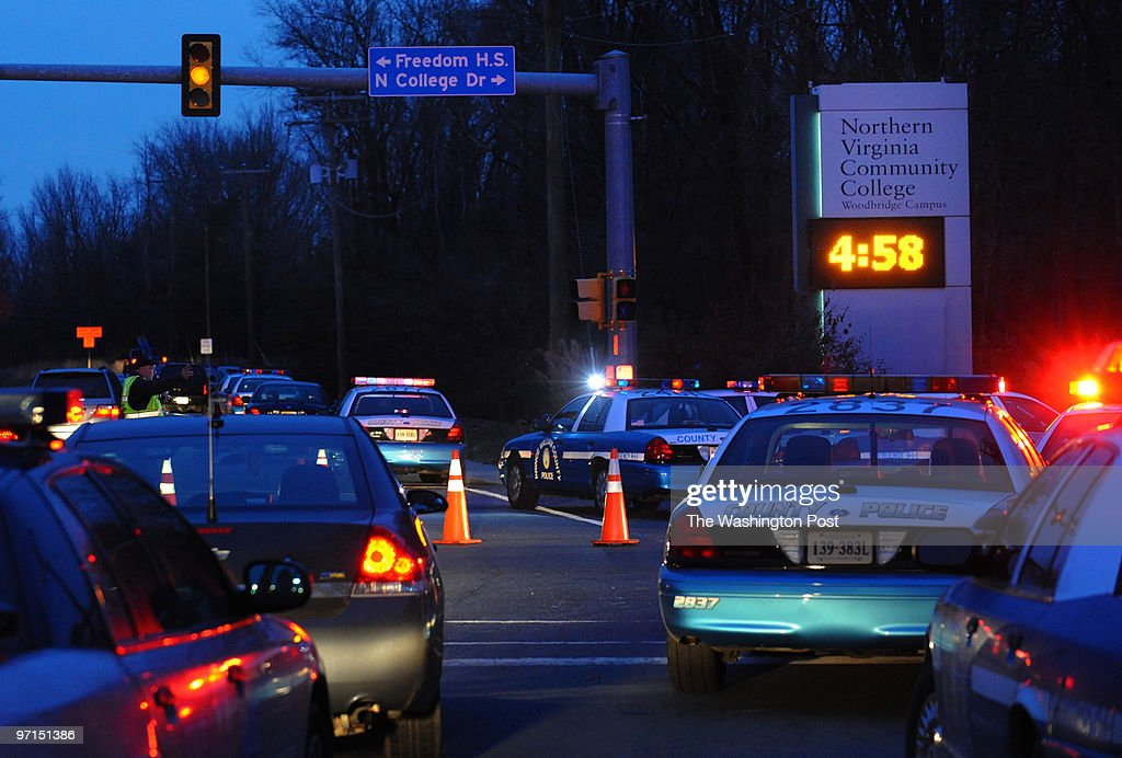 meshooting DATE December 8 2009 CREDIT Toni L Sandys / TWP Woodbridge VA Prince William County Police direct traffic around the entrance of the...