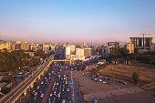 Aerial view of the traffic in Meskel Square with new light rail system and sunset tones. Addis Ababa, Ethiopia. Captured with a drone.