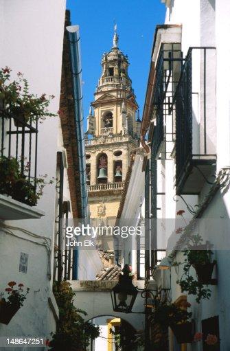 Mesquita minaret through Old Town buildings.