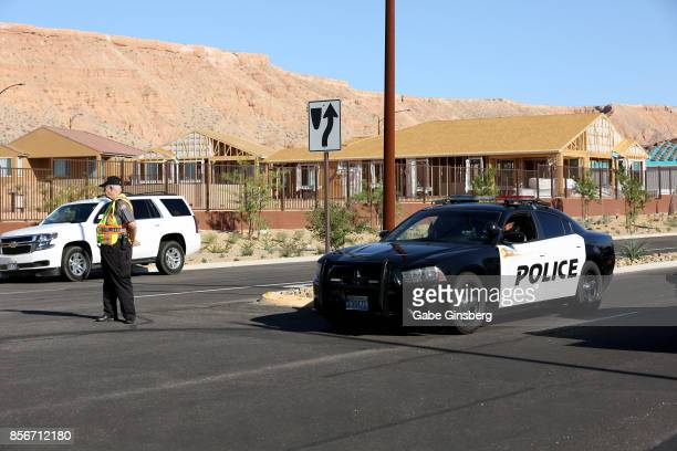 Mesquite Police Department citizen volunteer and a Mesquite Police car block access to the Sun City Mesquite community where suspected Las Vegas...
