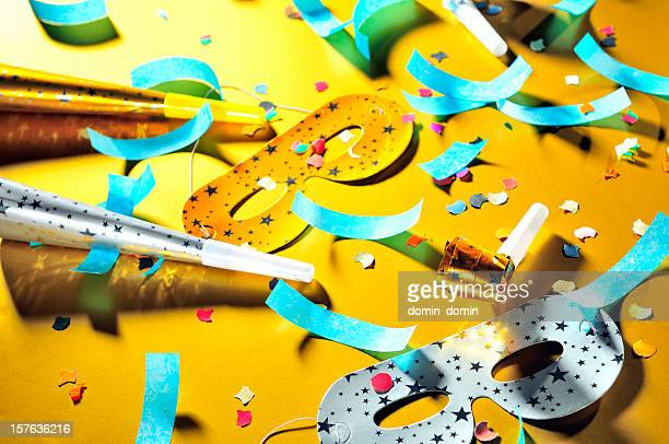 Mess after party, decorations: masks, whistles, horns, confetti scattered floor