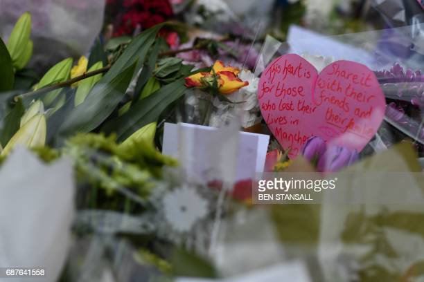 A message amongst flowers reads 'This heart is for those who lost their lives in Manchester' is pictured in St Ann's Square in Manchester northwest...