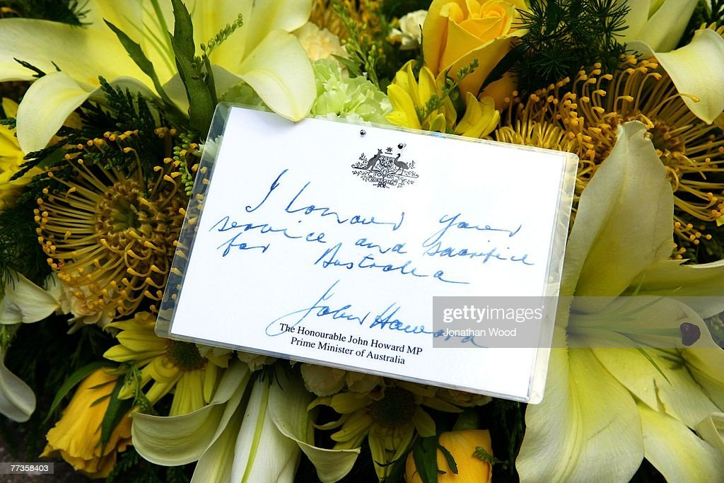 A message from Australian Prime Minister John Howard is seen on a bouquet of flowers at the military funeral of Trooper David Pearce the Cathedral of...