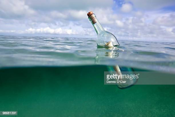 Message in a bottle floating in ocean