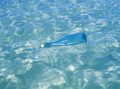 Message in a bottle floating on the water