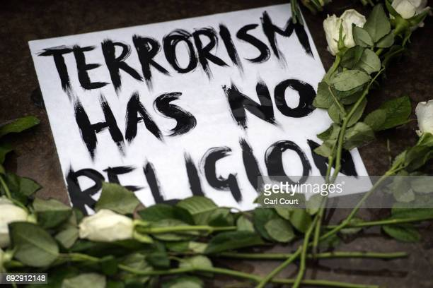 A message is left with flowers near the scene of Saturday's terrorist attack on June 6 2017 in London England The third attacker has been named by...