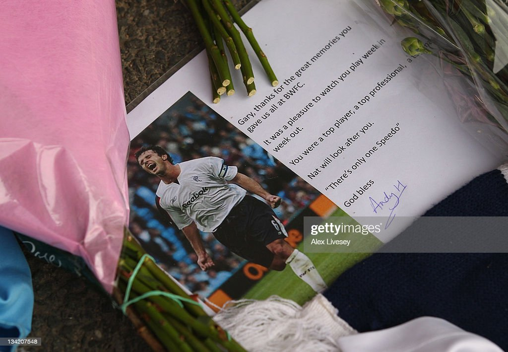 A message is seen amongst tributes to footballer and ex Bolton Wanderers player Gary Speed outside the Reebok Stadium the home ground of Bolton Wanderers FC on November 28, 2011 in Bolton, United Kingdom.