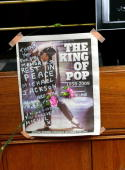 A message is written on the front of a London newspaper annoucing the death of singer Michael Jackson at a shrine auditorium to pay tribute to the...