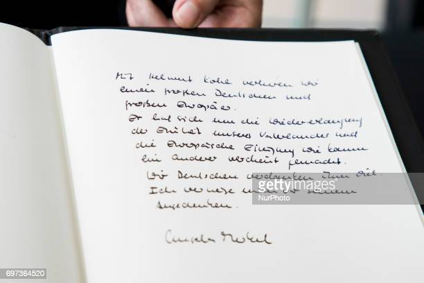 A message of German Chancellor Angela Merkel in a book of condolence for former Chancellor Helmut Kohl is pictured at the Chancellery in Berlin...