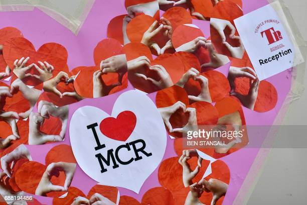 A message of support made up of hearts and including an 'I love MCR' sticker is pictured outside Victoria Station car park near to the Manchester...