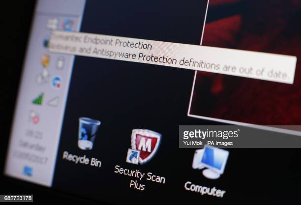 A message on a laptop screen from internet security software warning users of outdated antivirus and antispyware protection after the NHS has been...