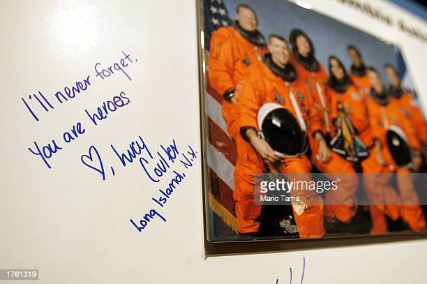 A message reading 'I'll Never Forget You Are Heroes' is written next to a photograph of the astronauts who were killed aboard the Space Shuttle...