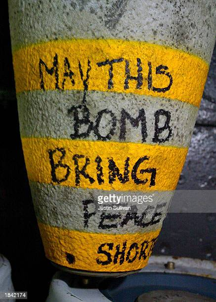 A message stating 'may this bomb bring peace' is written on the nose of a 1000 pound bomb aboard the USS Constellation March 11 2003 in the Arabian...
