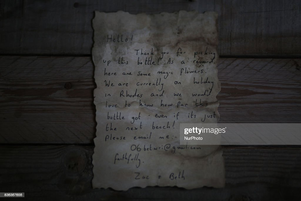 A message that was written by Bethany Wright and her boyfriend Zac Marriner, and found in a bottle by Palestinian fisherman Jihad al-Soltan off a Gaza beach, is seen in Gaza August 21, 2017. The Gazan fisherman says he contacted Bethany and Zac in greech who expressed being happy their message reachea Gaza and they pass their regarda to Palestinian people. Bethany and Zac have been contacted by joutnalists to find the origin of this message in a bottle story. They sent him photos of them through email. They said they are happy their message reached Gaza.
