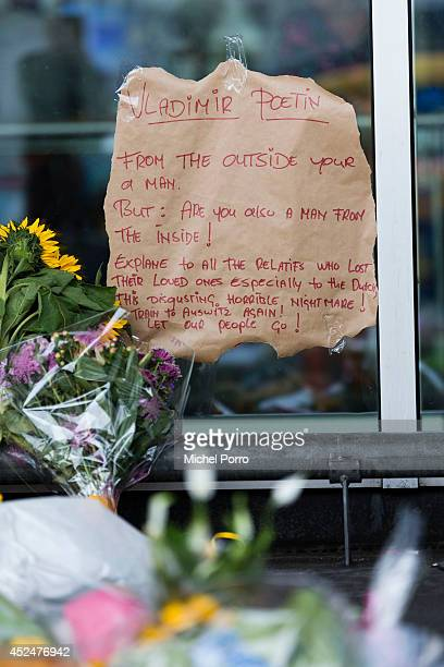 A message to Russian president Putin is seen at a makeshift memorial for the passengers aboard doomed flight Malaysia Airlines MH17 at Schiphol...