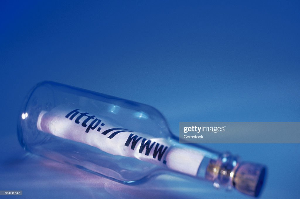 Message with web address inside bottle