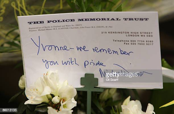 A message written by Michael Winner the founder and chairman of the Police Memorial Trust accompanies his floral tribute in front of a memorial stone...