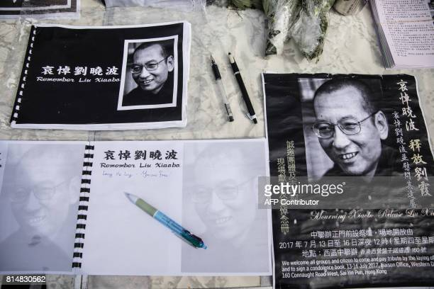 A message written in a condolence book by a supporter reading 'you are free' is seen at a makeshift memorial for the late Chinese Nobel laureate Liu...