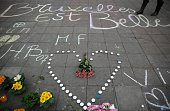 TOPSHOT A message written on the ground reads 'Brussels is beautiful' next to flowers and candles at a makeshift memorial following attacks in...