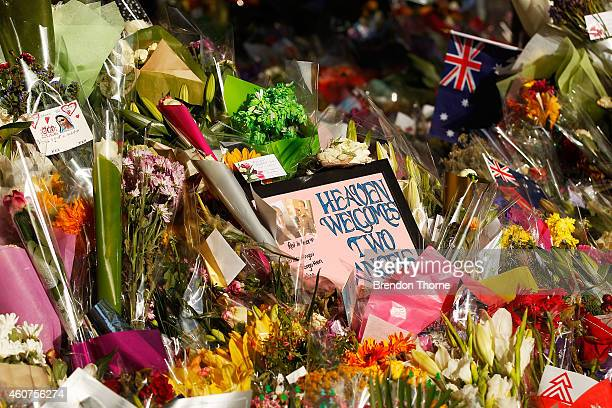 Messages and flowers are placed in respect outside the Lindt Cafe on December 22 2014 in Sydney Australia A memorial to the victims of a seige at...