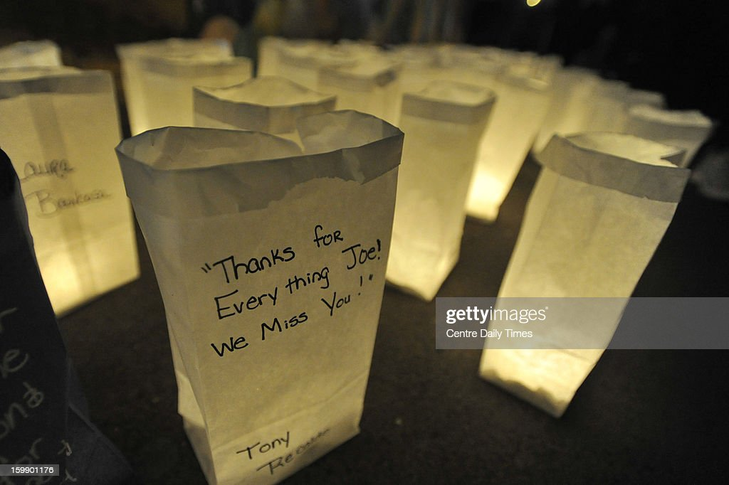 Messages are left to Joe Paterno on luminaries during a candlelight vigil marking one year since the football coach's death, at the Inspiration Mural in State College, Pennsylvania, on Tuesday, January 22, 2013.