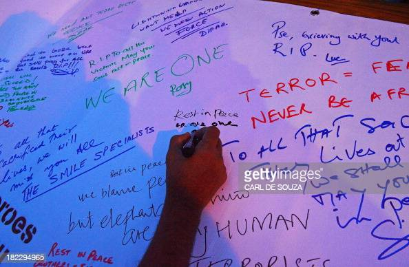 Messages are written on a sheet outside the Westgate Mall on September 29 2013 in Nairobi Kenyan police arrested today another suspect over the...