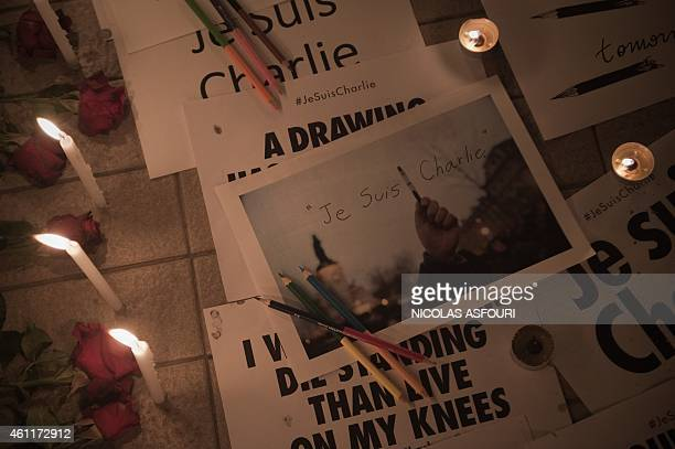 Messages flowers and candles are displayed outside the Cultural and Art centre in Bangkok in Bangkok on January 8 in tribute to the twelve people...