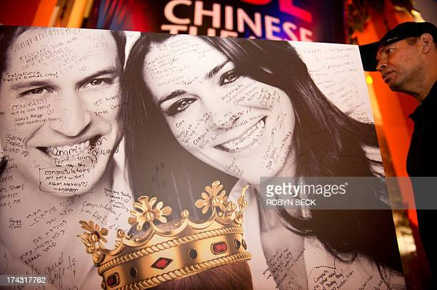 Messages from visitors and tourists are seen on a giant card to Britain's Prince William and Kate Duchess of Cambridge congratulating the royal...