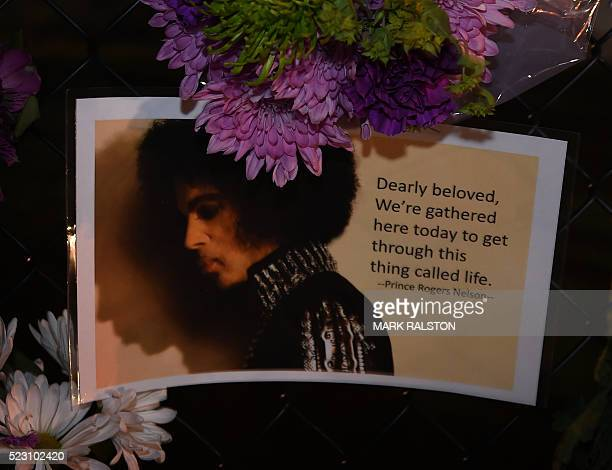 TOPSHOT Messages left by fans outside the Paisley Park residential compound of music legend Prince in Minneapolis Minnesota on April 21 2016...