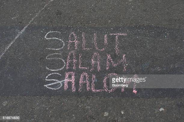 Messages of condolence and support sit chalked at Beursplein square in Brussels Belgium on Tuesday March 22 2016 Explosions ripped through the...