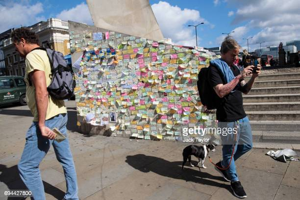 Messages of support and condolence sit on a wall on the south end of London Bridge following the June 3rd attacks on June 10 2017 in London England...