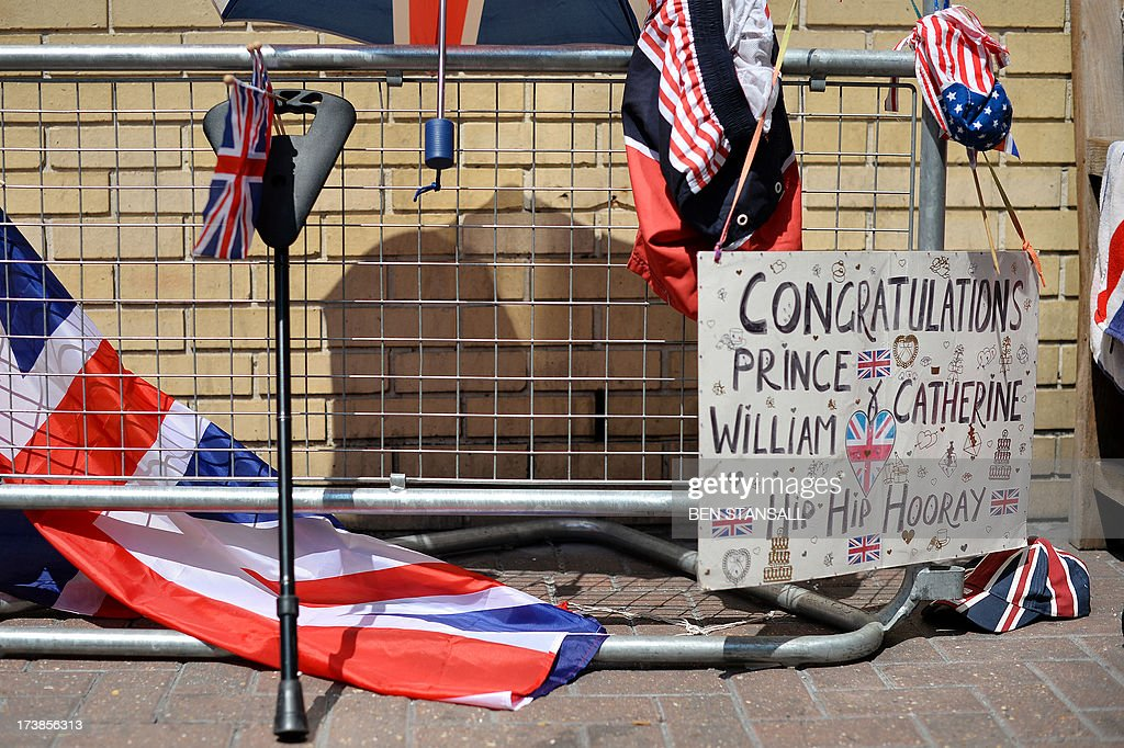 Messages of support and flags are pictured outside the Lindo Wing of St Mary's Hospital in London, on July 18, 2013, where Prince William and his wife Catherine's baby is expected to be born. The long wait for the birth of Britain's royal baby is record business for bookmakers, as punters worldwide bet on a girl called Alexandra to be born any day now.