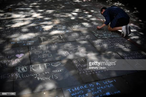 Messages of support are written in chalk in Saint Ann's Square in tribute to those killed in an explosion at the Manchester Arena earlier this week...