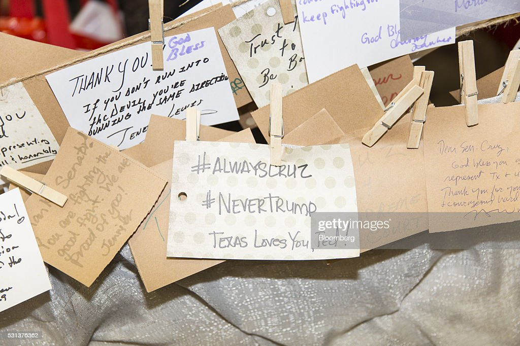Messages of support for Senator Ted Cruz a Republican from Texas and former 2016 presidential candidate hang at the Cruz campaign booth during the...