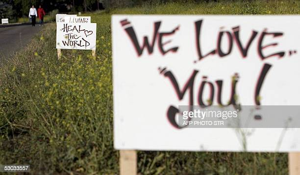 Messages placed by fans of Michael Jackson line Figueroa Mountain Road which leads to the US pop icon's Neverland Ranch 07 June 2005 in Los Olivos...