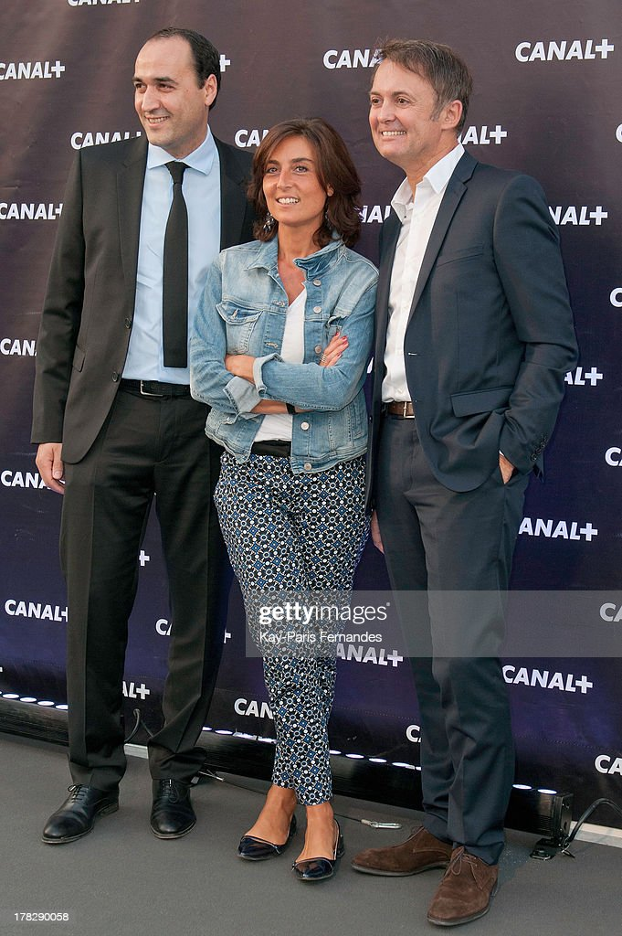 Messaoud Benterki (r) , Journalist Nathalie Iannetta (c) and Eric Besnard at the 'Rentree De Canal +' photocall at Porte De Versailles on August 28, 2013 in Paris, France.
