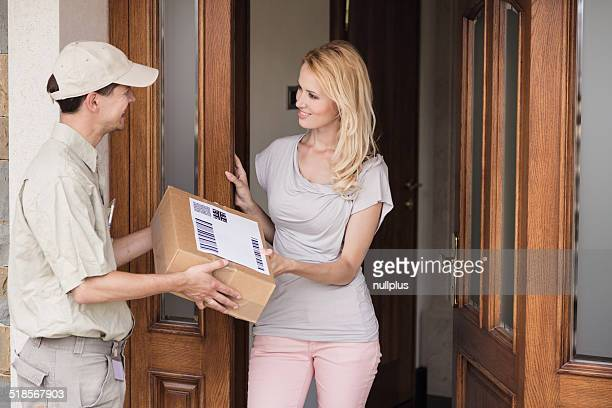 messenger handing parcel to customer
