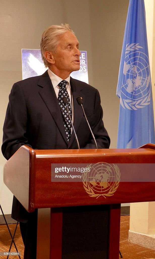 UN Messenger of Peace Michael Douglas delivers a speech and congratulates the winners of 'Disarmament Poster for Peace' competition, organized by United Nations Disarmament Department during a reception held for ranking the highest competitors, at United Nations Office in New York, USA on May 4, 2016.